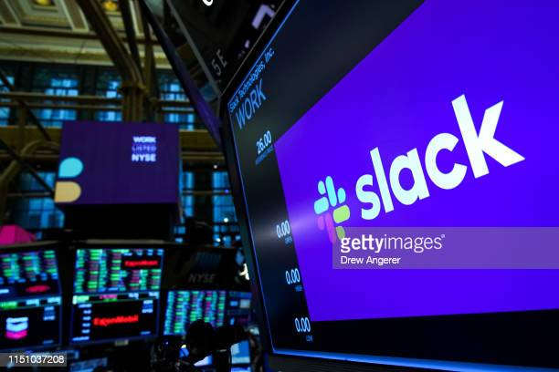 The logo for Slack is displayed on a trading post monitor at the New York Stock Exchange , June 20, 2019 in New York City. The workplace messaging...