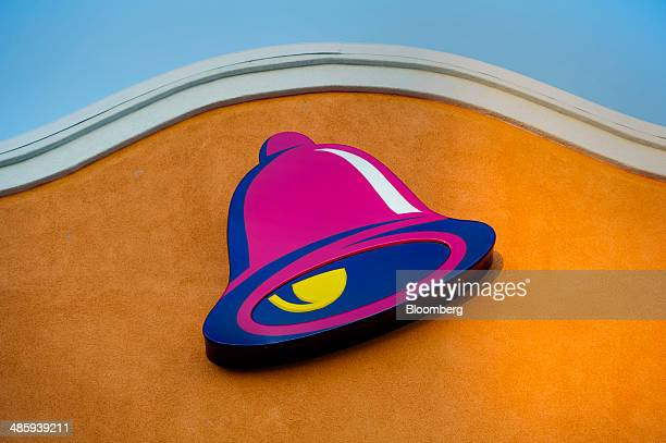 The logo for Taco Bell a unit of Yum Brands Inc is displayed outside of a restaurant in Daly City California US on Friday April 18 2014 Yum Brands...