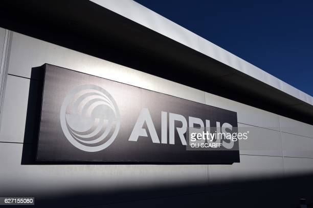 The logo for the aircraft manufacturer Airbus is pictured outside their wing assembly plant near Broughton in northeast Wales on December 1 2016...