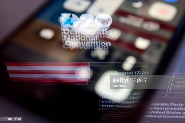 The logo for the Democratic Convention is seen reflected on the screen of a phone in a photoillustration captured on August 12 2020 in Philadelphia...