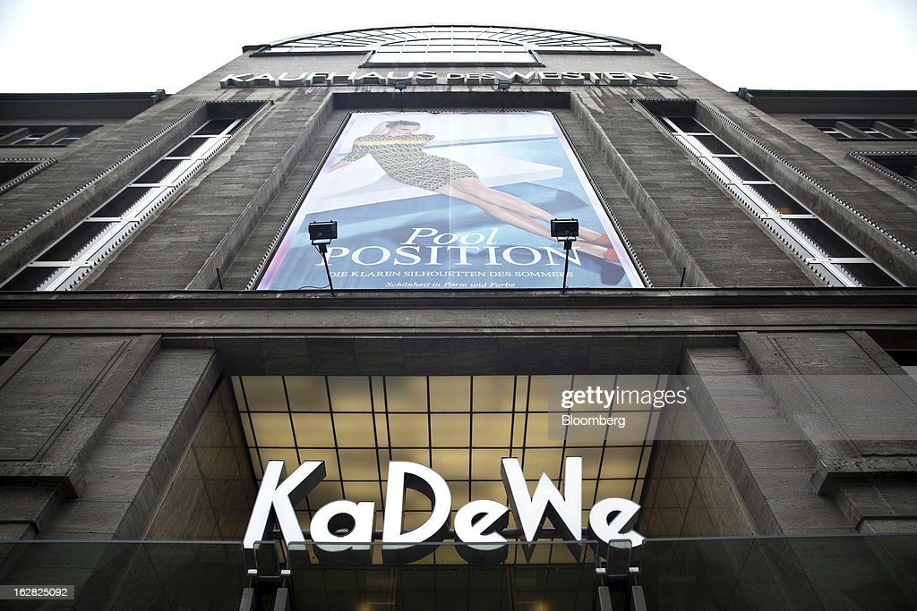 The logo for the KaDeWe, or Kaufhaus des Westens department store is seen in Berlin, Germany, on Wednesday, Feb. 27, 2013. German unemployment unexpectedly fell in February amid signs that Europe's biggest economy is returning to growth after a contraction at the end of last year. Photographer: Balint Porneczi/Bloomberg via Getty Images