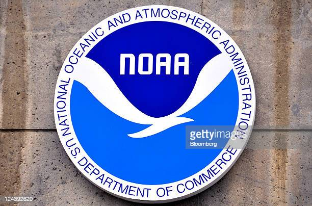 The logo for the National Oceanic and Atmospheric Administration hangs near the entrance to the National Weather Service's National Hurricane Center...