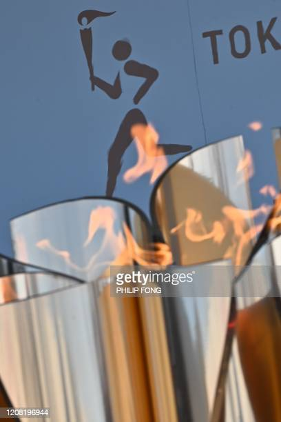The logo for the Tokyo 2020 torch relay is pictured as the Olympic flame goes on display at the Aquamarine Fukushima aquarium in Iwaki in Fukushima...