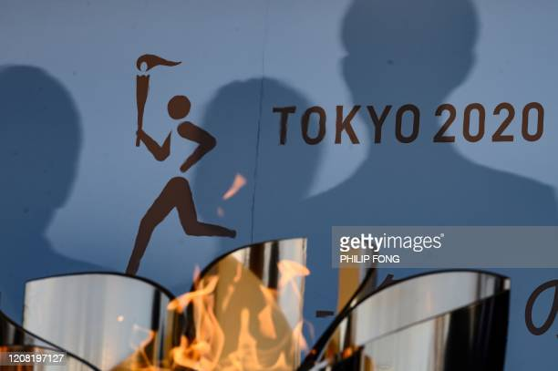 TOPSHOT The logo for the Tokyo 2020 torch relay is pictured as the Olympic flame goes on display at the Aquamarine Fukushima aquarium in Iwaki in...