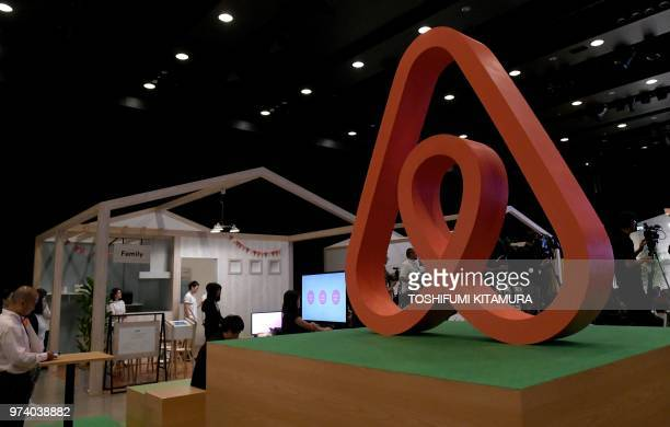 The logo for US rental site Airbnb is displayed during the company's press conference in Tokyo on June 14 2018