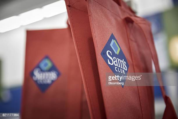 The logo for WalMart Stores Inc's Sam's Club is displayed on a shopping bag inside one of the company's store in Zhuhai China on Friday Oct 14 2016...