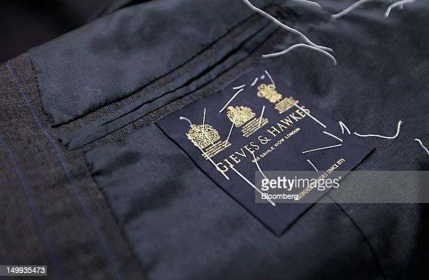 The logo Gieves Hawkes owned by Trinity Ltd is seen on the inside of a jacket at the company's store on Savile Row in London UK on Tuesday Aug 7 2012...