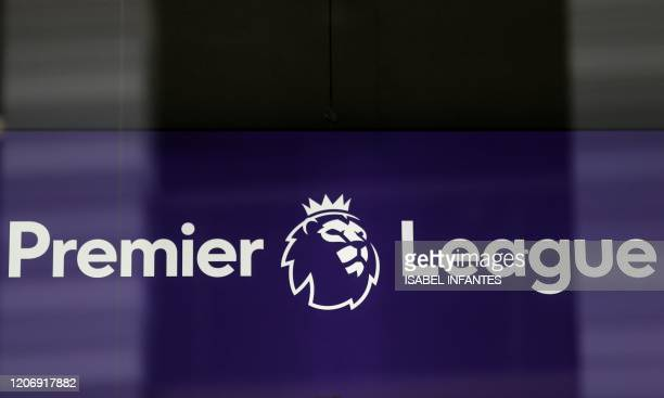 The logo is pictured through a glass window at the headquarters of the English Premier League in London on March 13, 2020. - The English Premier...