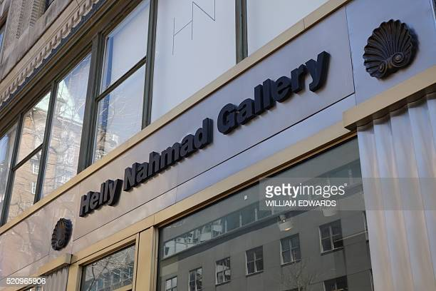 The logo is seen at the Helly Nahmad gallery in New York on April 13 2016 A Modigliani painting allegedly looted by Nazis during World War II has...
