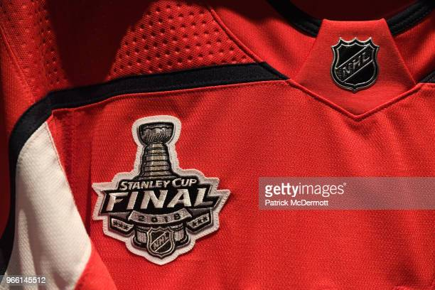 The logo is seen on a jersey in the Washington Capitals locker room before Game Three of the 2018 NHL Stanley Cup Final between the Vegas Golden...