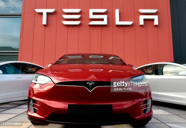 The logo marks the showroom and service center for the US automotive and energy company Tesla in Amsterdam on October 23, 2019.