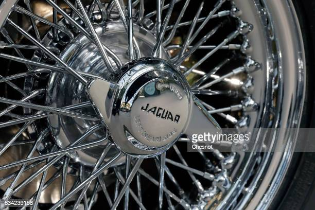 The logo of a Jaguar EType is seen on a rim during a press preview before a mass auction of vintage vehicles organised by Bonhams auction house at...