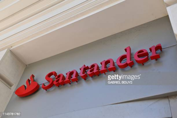 The logo of a Santander bank is pictured in Madrid on May 14 2019 Spanish banking giant Santander wants to slash around 3700 jobs in Spain or about...