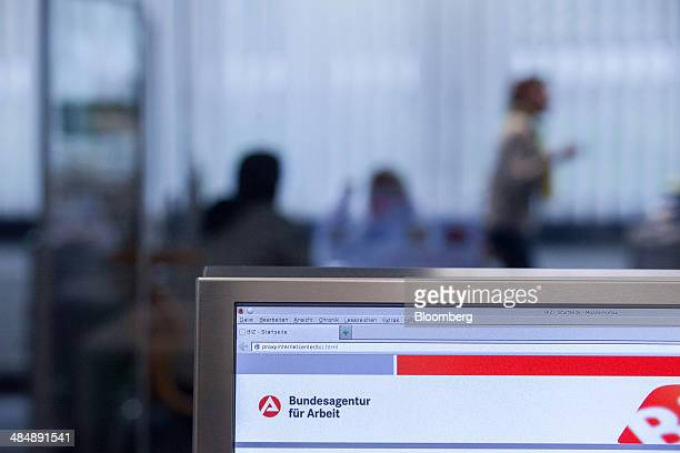 The logo of Agentur fuer Arbeit sits a desktop computer monitor inside a employment office in Stuttgart Germany on Monday April 14 2014 German...