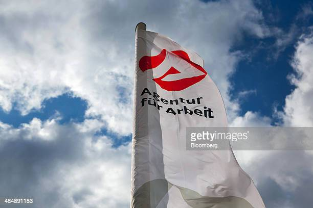 The logo of Agentur fuer Arbeit sits on a banner flying outside a employment office in Stuttgart Germany on Monday April 14 2014 German unemployment...