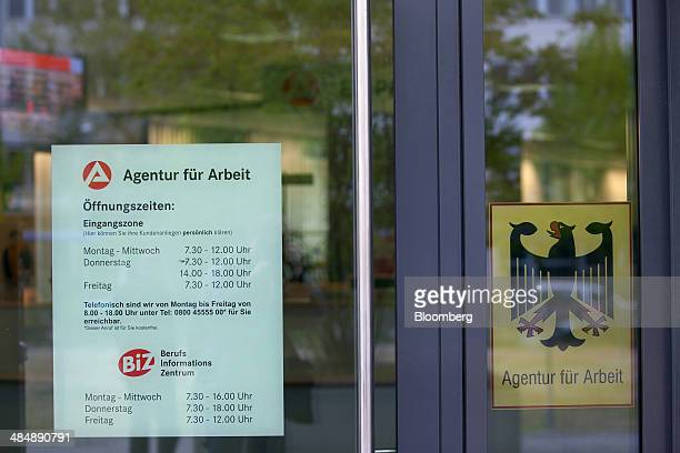 The logo of Agentur fuer Arbeit sits on a sign displaying the opening hours of a employment office in Stuttgart Germany on Monday April 14 2014...