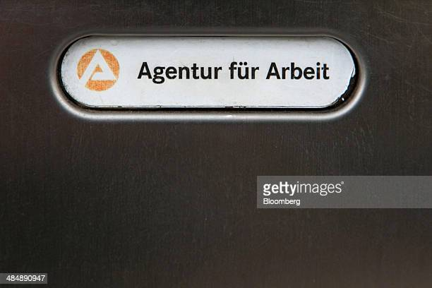 The logo of Agentur fuer Arbeit sits on a sign outside a employment office in Stuttgart Germany on Monday April 14 2014 German unemployment fell for...