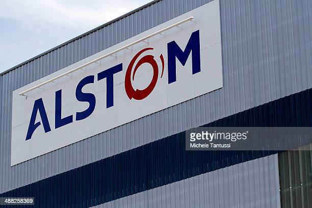 The Logo of Alstom SA hangs on the wall of the Production plant on May 5 2014 in Belfort France General Electric is seeking to take over Alstom one...