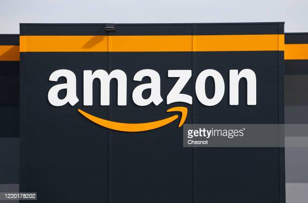 The logo of Amazon is seen on the facade of the company logistics center on April 21, 2020 in Bretigny-sur-Orge, France. The French government has...