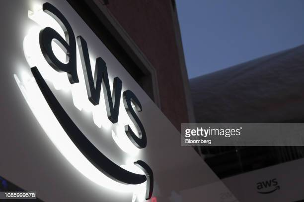 The logo of Amazon Web Services Inc is displayed on a sign at a pop-up office ahead of the World Economic Forum in Davos, Switzerland, on Monday,...