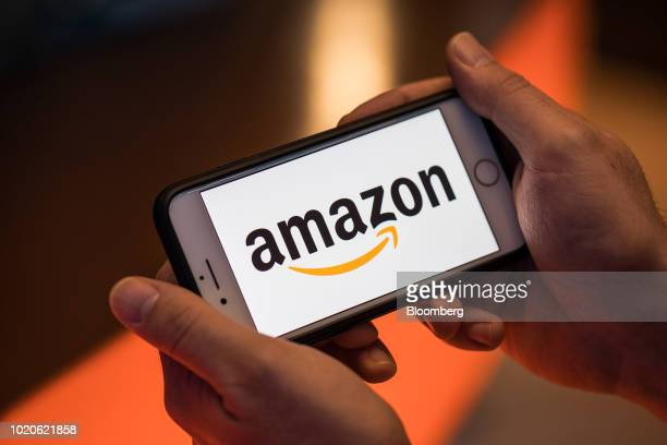 The logo of Amazoncom Inc sits on an Apple Inc iPhone smartphone in this arranged photograph in London UK on Monday Aug 20 2018 The NYSE FANG Index...