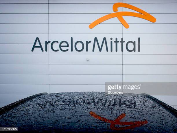 The logo of ArcelorMittal is reflected on a vehicle's roof at the company's headquarters in Bremen Germany on Wednesday Nov 4 2009 ArcelorMittal the...