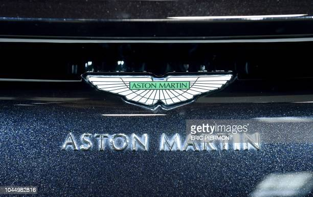 The logo of Aston Martin is seen on a car displayed at the Aston Martin stand during the press days of the Paris Motor Show on October 3 2018 Aston...