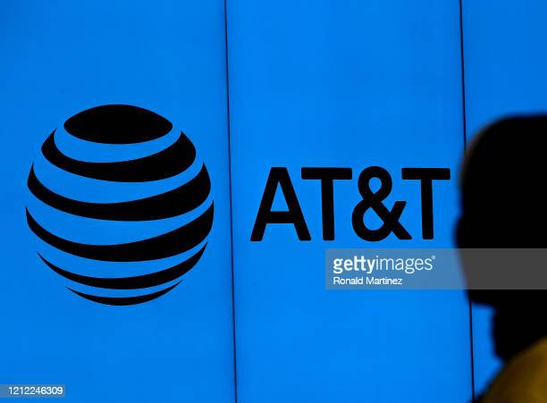 The logo of AT&T outside of AT&T corporate headquarters on March 13, 2020 in Dallas, Texas. AT&T is allowing employees to work remotely from home if...