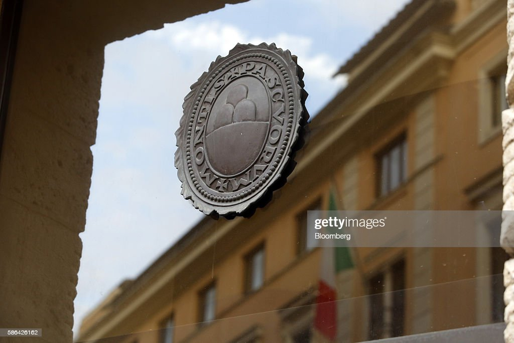 The Logo Of Banca Monte Dei Paschi Di Siena Spa Sits On The Window