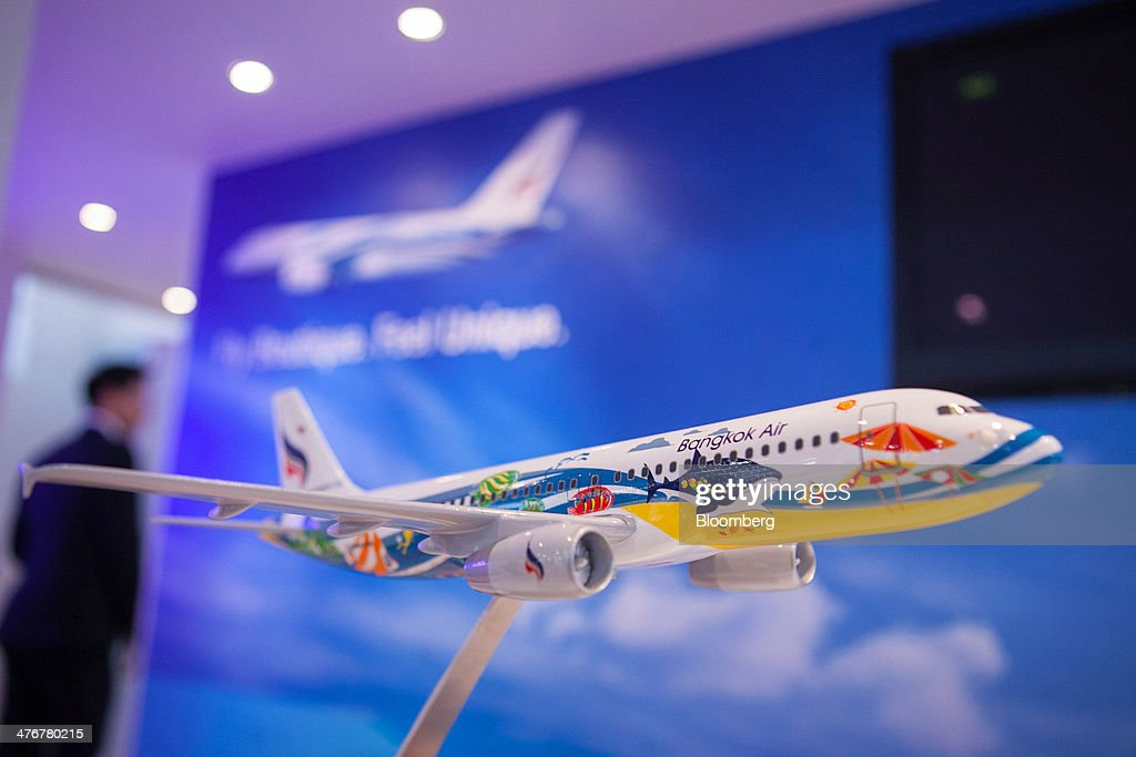 The logo of Bangkok Airways Co. sits on a model aircraft at the ITB Berlin tourism fair at Messe Berlin exhibition center in Berlin, Germany, on Wednesday, March 5, 2014. Archaic rules, taxes as high as those imposed on alcohol and an infrastructure deficit, especially in Asia, are curbing the aviation industry's growth, the International Air Transport Association said. Photographer: Krisztian Bocsi/Bloomberg via Getty Images