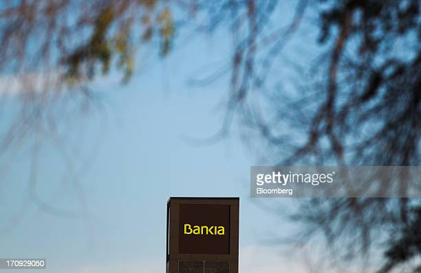 The logo of Bankia SA branch sits on the bank's offices in Las Rozas Spain on Tuesday June 18 2013 Bailing out Bankia SA Spain's fourthbiggest...