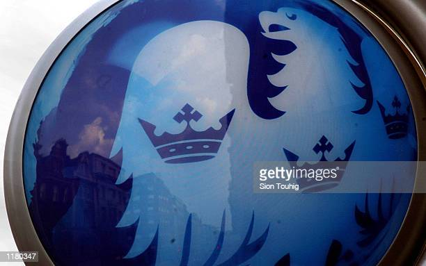 The logo of Barclays Bank is displayed above a bank branch July 29 2002 on Regent Street in London England Barclays will announce its semiannual...