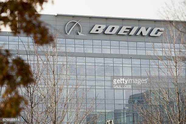 The logo of Boeing is seen on Boeing's Government Operations office in Arlington Virginia on December 13 2016 / AFP / SAUL LOEB