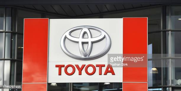 The logo of car dealership and manufacture Toyota is seen outside its stores on November 12, 2020 in Stoke-on-Trent, Staffordshire, England.