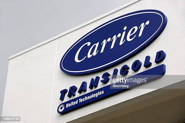 The logo of Carrier Transicold a unit of United Technologies Ltd is displayed outside the company's production plant in Singapore on Friday May 10...