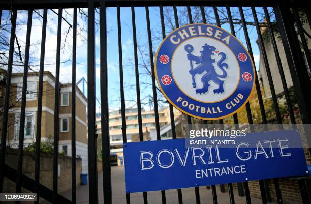 The logo of CHelsea Football Club is pictured on a closed gate at Stamford Bridge football stadium in London on March 13 2020 The English Premier...