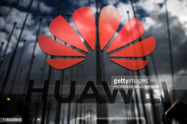 The logo of Chinese telecom giant Huawei is pictured during the Web Summit in Lisbon on November 6 2019 Europe's largest tech event Web Summit is...