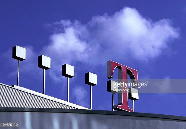 The logo of Deutsche Telekom is seen on top of the company's headquarters prior to a press conference in Bonn, Germany, Thursday, August 10, 2006....