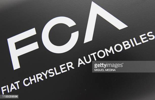 The logo of Fiat Chrysler Automobiles is pictured at the Mirafiori plant in Turin on July 11 2019 within the inauguration of the assembly line of the...