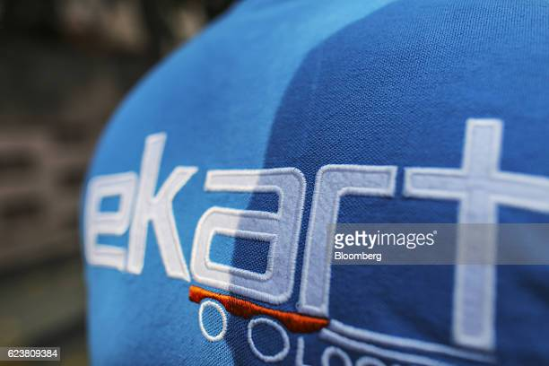 The logo of Flipkart Online Services Pvt's Ekart Logistics service is seen on the back of a shirt worn by Abdul Saleem a deliveryman known as a...