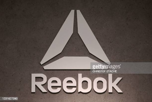The logo of footwear and clothing company Reebok, a subsidiary of German sporting goods giant Adidas, is seen in a store on March 10, 2021 in Munich,...
