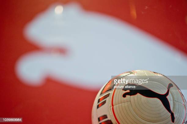 The logo of footwear and sportswear manufacturer is seen ona soccer ball and in the background at the annual general meeting of Puma SE in...