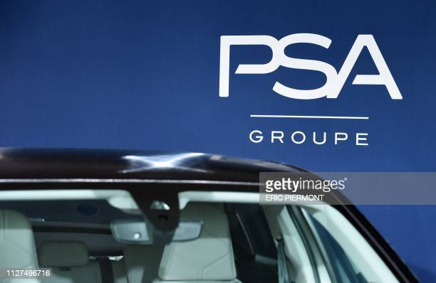 The logo of French carmaker PSA Groupe is displayed at the PSA Groupe headquarters in Rueil-Malmaison on February 26, 2019.