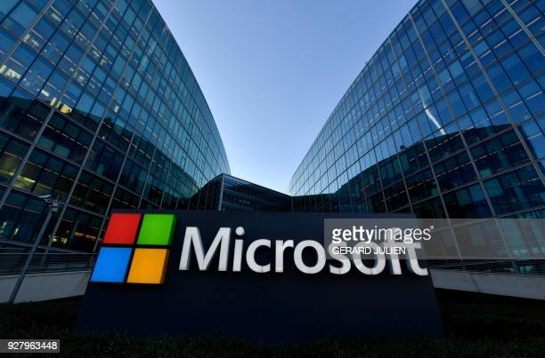The logo of French headquarters of American multinational technology company Microsoft is pictured outside on March 6 2018 in IssyLesMoulineaux a...