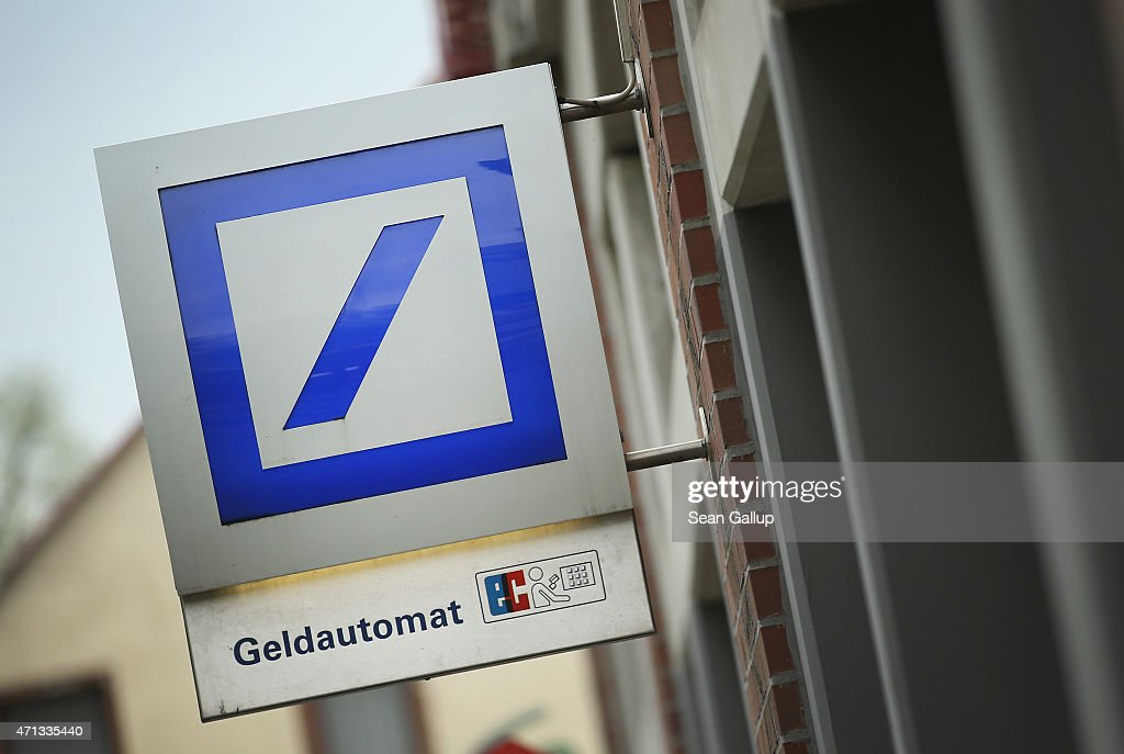 The logo of German bank Deutsche Bank hangs over one of the bank's branches on April 27, 2015 in Berlin, Germany. Deutsche Bank announced earlier in the day that it will close 200 of its 700 branches in Germany over the next two years in an effort to save an annual EUR 3.5 billion.