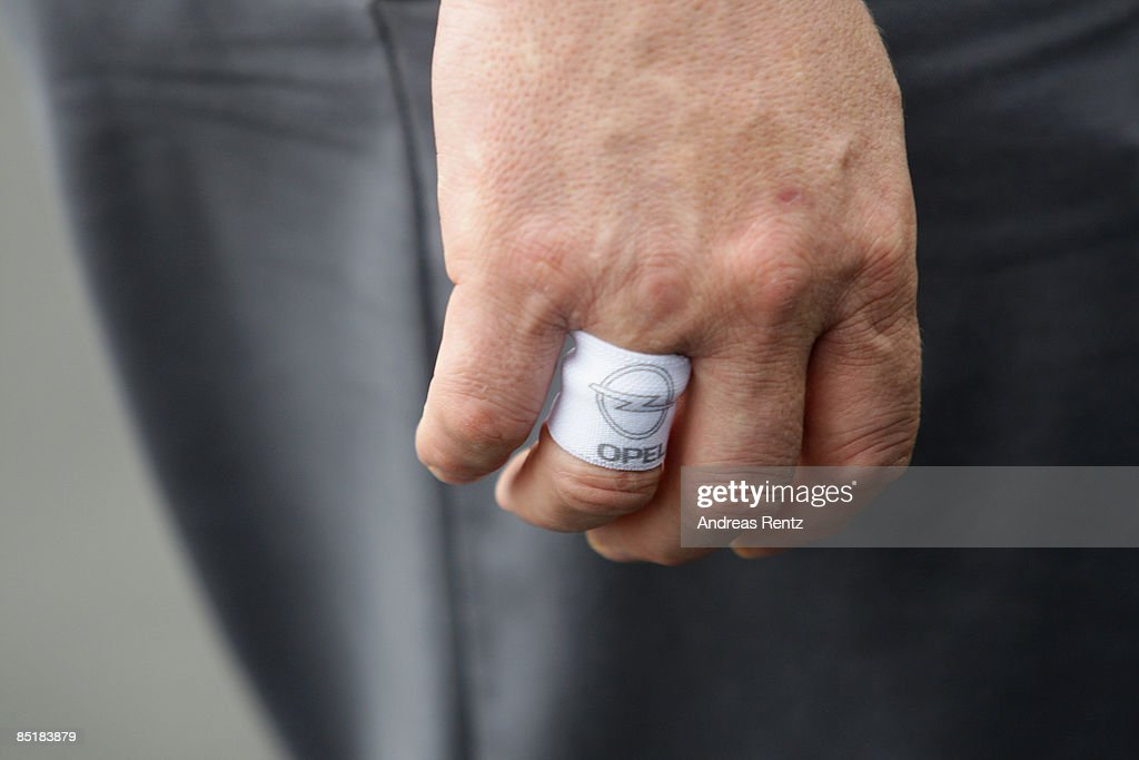 The logo of German car maker Opel AG is seen on a finger of an Opel employee on March 2, 2009 in Eisenach, Germany. Opel announces a business plan directed to the German government to substantiate the demand for subsidy. Opel needs a rescue package of 3.3 billion euros to stay solvent due to serious difficulties of GM.