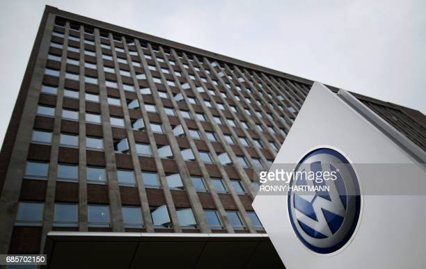 The logo of German car maker Volkswagen stands outside the main administrative building of the Volkswagen brand at VW plant in Wolfsburg central...