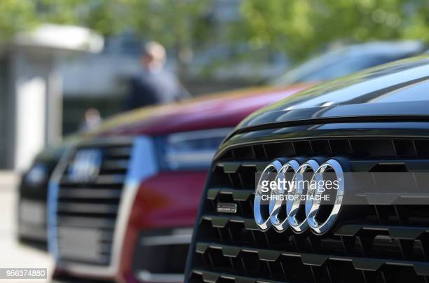 The logo of German carmaker Audi is pictured on new Audi cars on the sidelines of the Audi AG annual general meeting in Ingolstadt, southern Germany,...