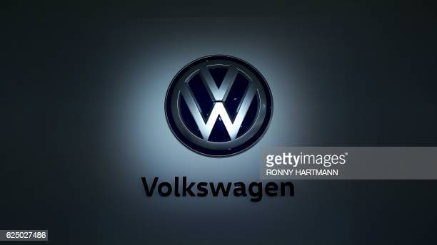 The logo of German carmaker Volkswagen is pictured at the company's head quarters on November 22 2016 in Wolfsburg northern Germany HARTMANN