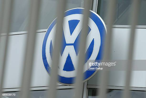 The logo of German carmaker Volkswagen stands outside a Volkswagen car dealership behind bars on September 22 2015 in Berlin Germany Volkswagen CEO...